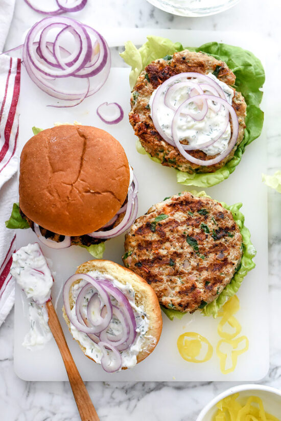 Healthier Fast Food: Greek Turkey Burgers with Tzatziki Sauce from FoodieCrush | The Health Sessions